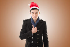 Young man with christmas hat Stock Image