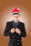 Young man with christmas hat Stock Photos