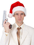 Young man in Christmas hat with gun Royalty Free Stock Photos