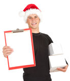 Young man in Christmas hat keeping blank clipboard Stock Images