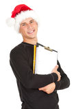 Young man in Christmas hat keeping blank clipboard Stock Photos