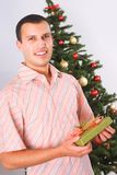 Young man with christmas present Stock Photo