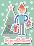 Young man with Christmas shopping at hand. Royalty Free Stock Photography