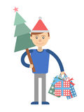 Young man with Christmas shopping at hand. Royalty Free Stock Image
