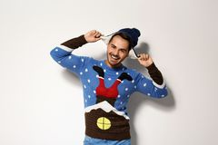 Young man in Christmas sweater and hat. On white background stock photos