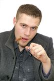 Young man with cigar Royalty Free Stock Photos