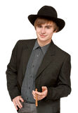 Young man with cigar in hat Stock Image