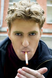 Young man with a cigarette Stock Photo