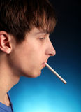 Young Man with Cigarette Royalty Free Stock Photo