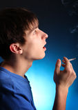 Young Man with Cigarette Stock Photo