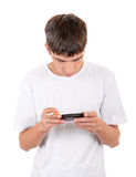 Young Man with Cigarette and Gadget Stock Photography