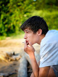 Young Man with Cigarette Royalty Free Stock Photography