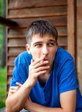 Young Man with a Cigarette Stock Image