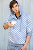 Young man with cigarettes Royalty Free Stock Photography