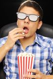 Young man at cinema royalty free stock photography