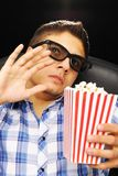 Young man at cinema stock photos