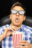 Young man at cinema stock photography