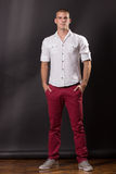Young man classic posing standing 20 years old pants shirt casua Royalty Free Stock Images