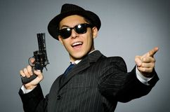 Young man in classic striped costume holding gun Royalty Free Stock Images