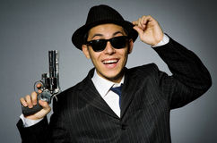Young man in classic striped costume holding gun Stock Photo