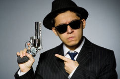 Young man in classic striped costume holding gun Royalty Free Stock Image