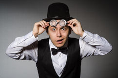The young man in classical black vest and hat Stock Images