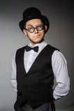 The young man in classical black vest and hat Royalty Free Stock Image