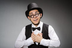 The young man in classical black vest and hat against gray Royalty Free Stock Photos