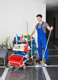 Young man with cleaning equipment royalty free stock image