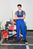Young man with cleaning equipment Stock Photography