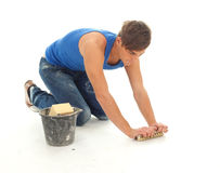 Young man cleaning floor Stock Image
