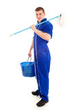 Young man cleaning the floor, full lenght Stock Image