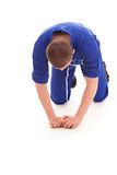 Young man cleaning the floor, full lenght Royalty Free Stock Photography