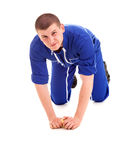 Young man cleaning the floor, full lenght Royalty Free Stock Photo