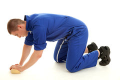 Young man cleaning the floor, full lenght Stock Photos