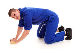 Young man cleaning the floor, full lenght Royalty Free Stock Images
