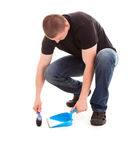 Young man cleaning the floor Royalty Free Stock Image