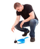 Young man cleaning the floor Royalty Free Stock Photo