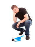 Young man cleaning the floor Royalty Free Stock Images