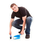 Young man cleaning the floor Royalty Free Stock Photography