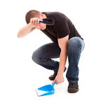 Young man cleaning the floor Stock Images