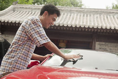 Young Man Cleaning His Car Royalty Free Stock Image