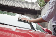 Young Man Cleaning His Car Stock Photo