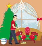 Young man cleaning house before Christmas Royalty Free Stock Photo