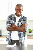Young Man Cleaning Modern Kitchen Royalty Free Stock Image