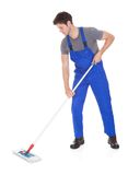 Young man cleaning with mop Royalty Free Stock Images