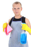 Young man with cleaning supplies Stock Images
