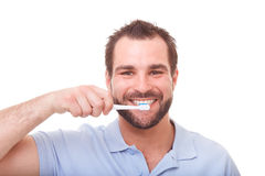 Young man cleans teeth Royalty Free Stock Photography