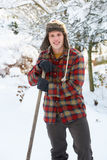 Young man clearing snow Royalty Free Stock Image
