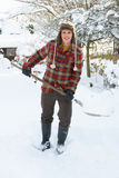 Young man clearing snow Royalty Free Stock Images